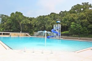 Kansas pool restoration with new water features.